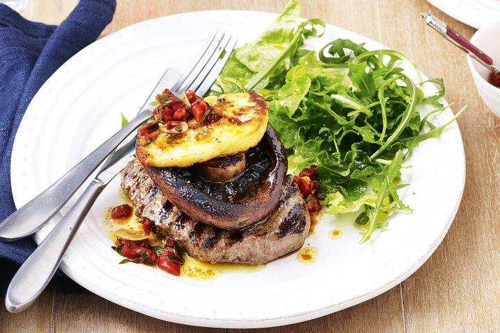 Steak and mushroom stacks on a plate.
