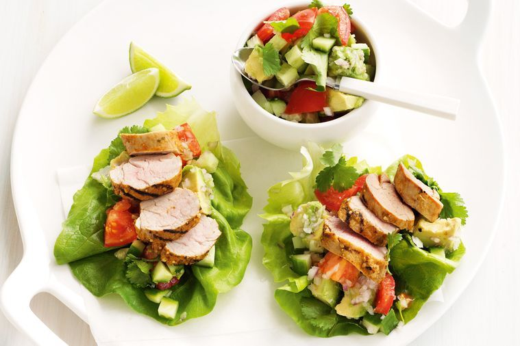Pork in lettuce cups served with avocado and lime salsa.